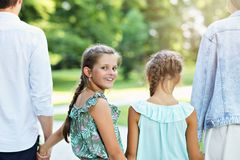 Young family with children having fun in nature royalty free stock image