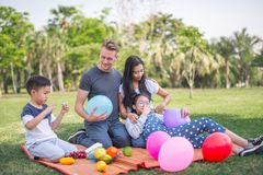 Young family with children having fun in nature. royalty free stock photography