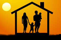 A young family with children in the house at sunset. Royalty Free Stock Photography