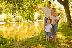 A young family with children in nature. A a young family with children in nature royalty free stock image