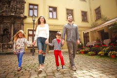 Young family with children on walk the street of tourist city. Young family with two children on a walk along the street of the tourist city royalty free stock photo