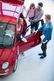 Young family chooses to buy a car Stock Photo