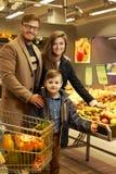 Young family choosing fruits Stock Photo