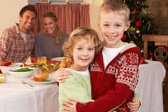 Young family at Christmas dinner table Stock Photo
