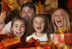 Young family with Christmas gifts Stock Images