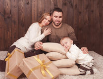Young family with christmas presents Royalty Free Stock Images