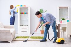 The young family cleaning the house. Young family cleaning the house stock image
