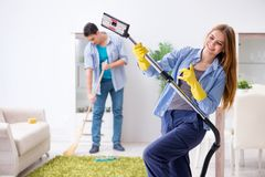 The young family cleaning the house. Young family cleaning the house stock photography