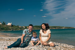 Young family on the coast Royalty Free Stock Photo