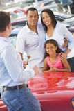 Young family collecting new car. From salesman Stock Photo