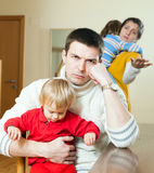 Young family conflict. Young upset  man against sadness woman Royalty Free Stock Images