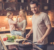 Young family cooking Stock Image