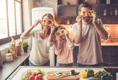 Young family cooking Stock Images