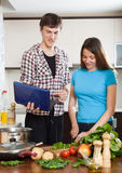 Young family cooking food Stock Photo