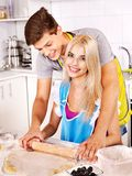 Young family cooking at kitchen. Royalty Free Stock Photo