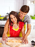 Young family cooking at kitchen. Stock Photo