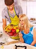 Young family cooking at kitchen. Young happy family cooking at kitchen royalty free stock photography