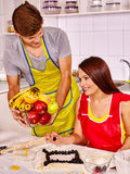 Young family cooking at kitchen. Young happy family cooking at kitchen royalty free stock image
