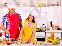 Young family cooking at kitchen. Young happy family cooking at kitchen royalty free stock photo