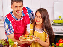 Young family cooking pizza at kitchen Royalty Free Stock Photography