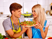 Young family cooking pizza at kitchen Stock Photos