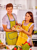 Young family cooking pizza at kitchen. Stock Image