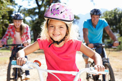 Young family on country bike ride Royalty Free Stock Image