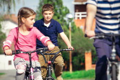 Young family on country bike ride Royalty Free Stock Photography