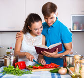Young family couple cooking vegetables Royalty Free Stock Photo