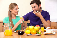 Young family couple having breakfast Stock Image
