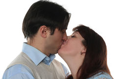 Young family couple kissing Stock Images