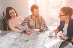 Young family couple purchase rent property real estate . Agent giving consultation to man and woman. Signing contract. Young family couple purchase rent property Stock Photo