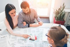Young family couple purchase rent property real estate . Agent giving consultation to man and woman. Signing contract. Young family couple purchase rent property Royalty Free Stock Photo