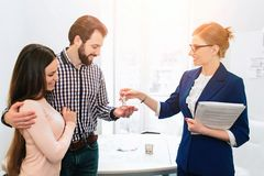 Young family couple purchase rent property real estate . Agent giving consultation to man and woman. Signing contract. Young family couple purchase rent property Stock Photos