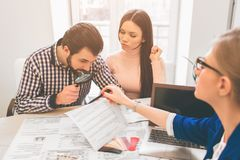 Young family couple purchase rent property real estate . Agent giving consultation to man and woman. Signing contract. Young family couple purchase rent property Stock Photography