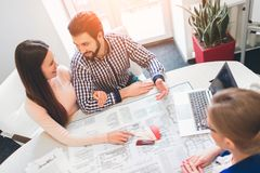 Young family couple purchase rent property real estate . Agent giving consultation to man and woman. Signing contract. Young family couple purchase rent property Stock Images
