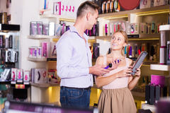 Young family couple selecting sex toys in shop Stock Image