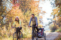 Young family cycling Stock Photo