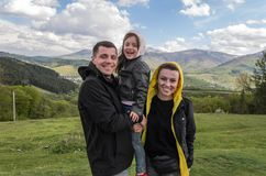 Young family: dad, mom and daughter during a vacation in the mountains stock photography