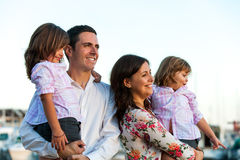 Young family with daughters at sunset. Royalty Free Stock Image