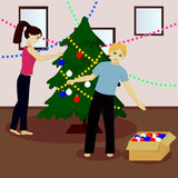 Young family decorate Christmas tree Royalty Free Stock Photos