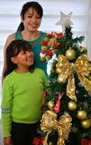 Young family decorating a Christmas Stock Photos