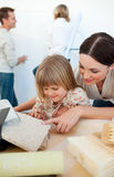 Young family decorating a room Royalty Free Stock Photography