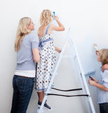 Young Family decorating their new home Stock Photo