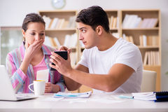The young family discussing family finances. Young family discussing family finances Stock Photo