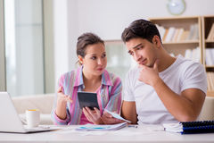 The young family discussing family finances. Young family discussing family finances Royalty Free Stock Photos
