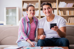 The young family discussing family finances Royalty Free Stock Photography