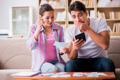 The young family discussing family finances Stock Photography