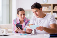 The young family discussing family finances Royalty Free Stock Image