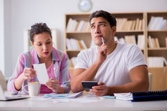 The young family discussing family finances. Young family discussing family finances Royalty Free Stock Images